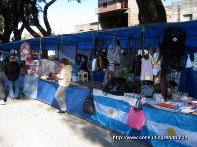 Feria de Mataderos booths with Argentina flags image